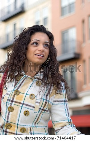 An attractive Indian woman out in the city. - stock photo
