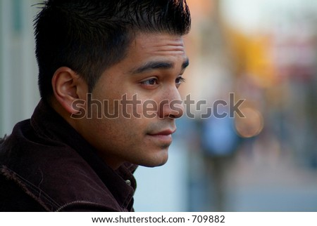 An attractive male looking out. - stock photo
