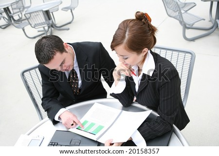 An attractive man and woman business team - stock photo