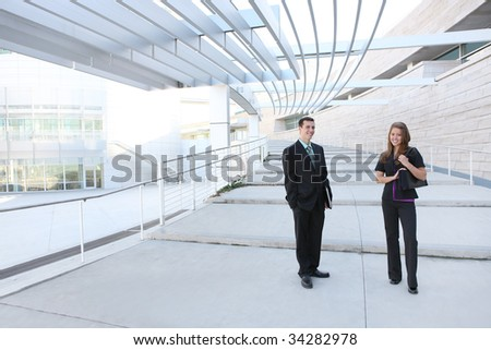 An attractive man and woman business team at the office - stock photo