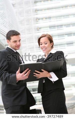 An attractive man and woman business team at their company - stock photo