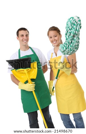 An attractive man and woman holding cleaning supplies - stock photo