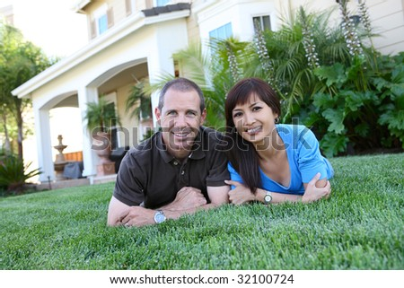 An attractive man and woman husband and wife at home - stock photo