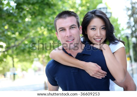 An Attractive man and woman Interracial couple in love - stock photo
