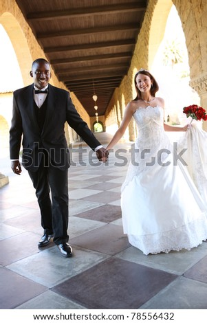 An attractive man and woman wedding couple ready to be married - stock photo