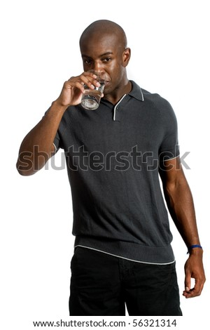 An attractive man drinking a glass of water against white background - stock photo