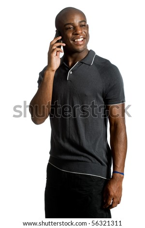 An attractive man talking on his mobile phone against white background