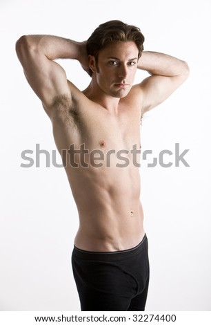An attractive man with just his underwear on - stock photo