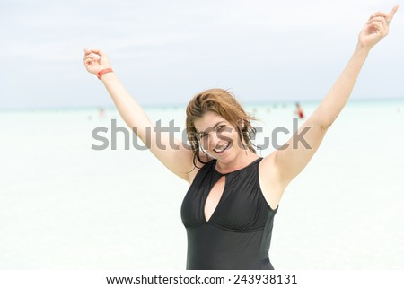 An attractive middle age woman enjoys a tropical beach - stock photo