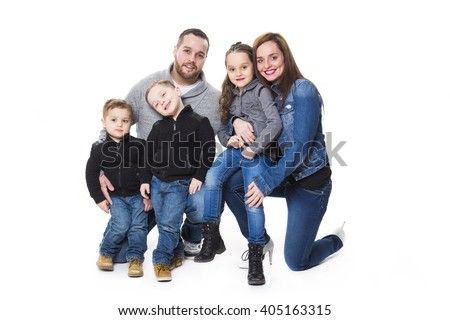 An attractive portrait of young happy family over white background - stock photo