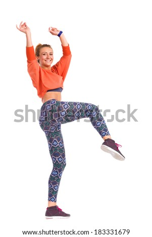 An attractive smiling young female dancing. Full length studio shot isolated on white. - stock photo
