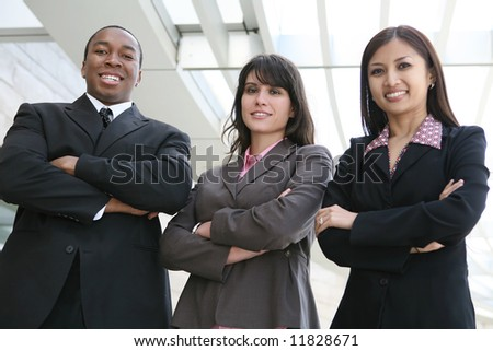 An attractive team of diverse business people smiling at company - stock photo