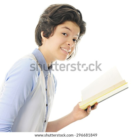 An attractive teen girl smiling at the viewer with the opened book she's been reading still in her hand.  On a white background. - stock photo