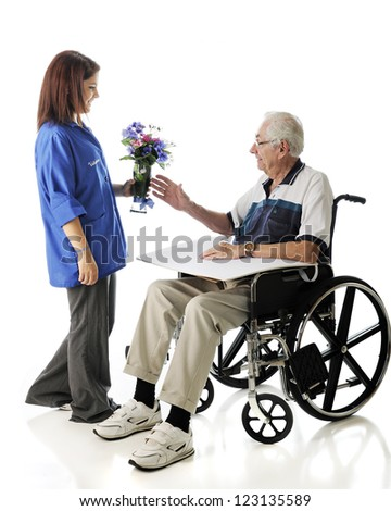 An attractive teen volunteer delivering a vase of flowers to an elderly man in a wheelchair.  On a white background. - stock photo