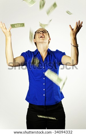 An attractive woman catching falling money - stock photo