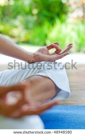 An attractive woman doing yoga outdoors - stock photo