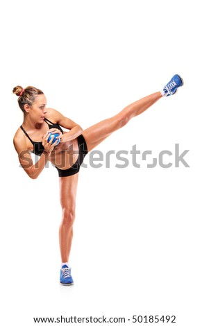 An attractive woman exercising isolated on white background - stock photo