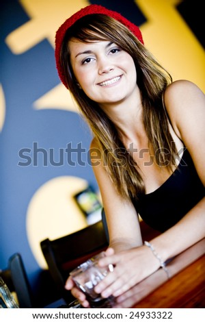 An attractive woman in a cafe with a glass of water - stock photo