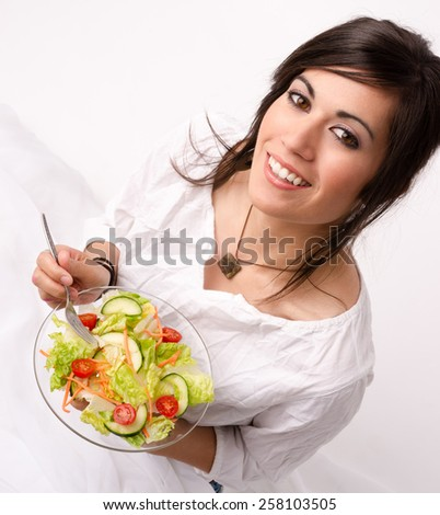 An attractive woman takes a moment to look at the camera before lunch - stock photo