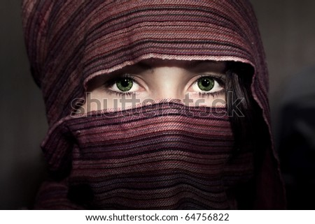 An attractive woman wearing a colorful head covering - stock photo