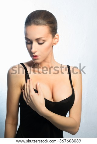 An attractive woman with big, beautiful breasts - stock photo