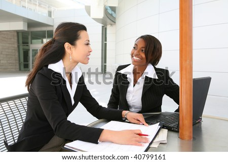 An attractive women business team working at office - stock photo