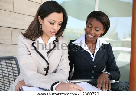An attractive women business team working with computer - stock photo
