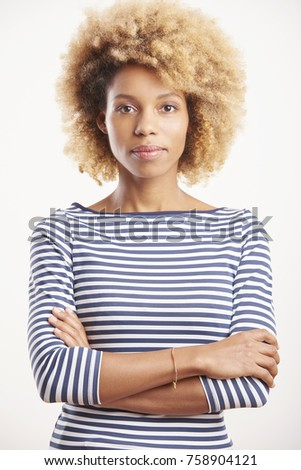 An attractive young afro-american woman standing with arms crossed at isolated white background.