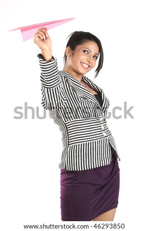 An attractive young businesswoman holding a paper plane - stock photo