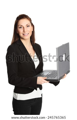 An attractive young businesswoman in her 20s standing wearing a white shirt and suit holding a laptop pc. White background. - stock photo