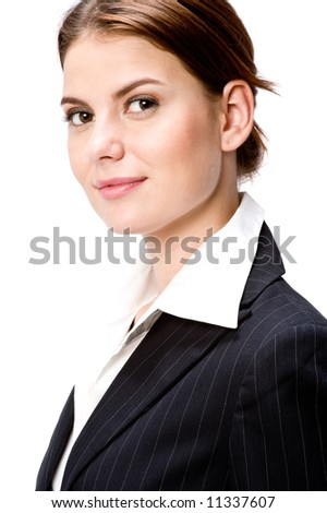 An attractive young businesswoman in suit jacket on white background - stock photo