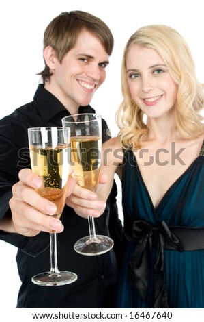 An attractive young couple drinking champagne together