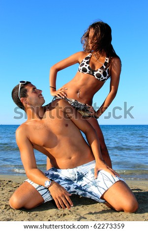 An attractive Young Couple enjoying the beach in Greece - stock photo