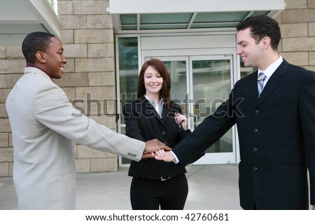 An attractive young diverse business man and woman team at office