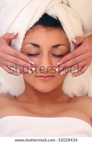 An attractive young lady getting a facial - stock photo