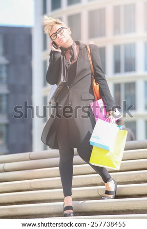 An attractive young lady out shopping - stock photo