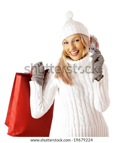 An attractive young lady out shopping. bags with purchases. isolated on white background - stock photo