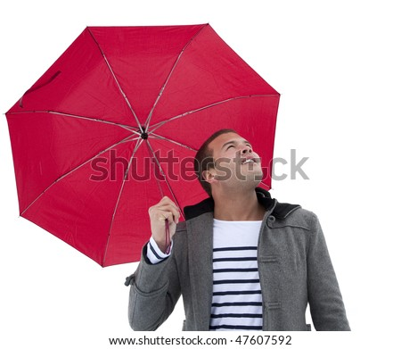 An attractive young male Watching the Weather - stock photo
