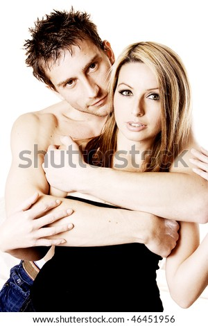 An attractive young man and woman cuddling.