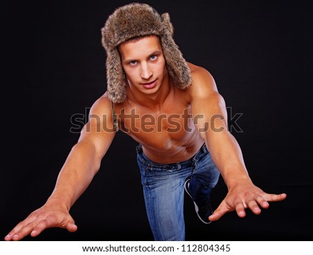 An attractive young man is leaping forward - stock photo