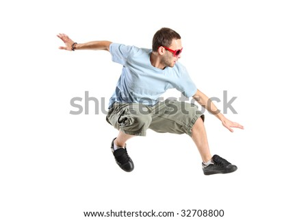 An attractive young man jumping in the air isolated on a white background - stock photo