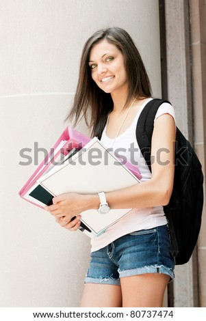 an attractive young student ready for class - stock photo