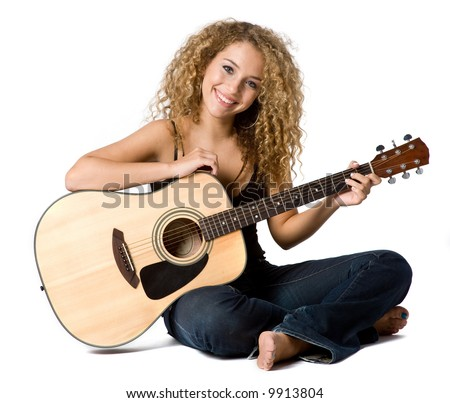 An attractive young teenage woman with an acoustic guitar on white background - stock photo