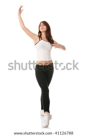 An attractive young woman doing various ballet poses - stock photo