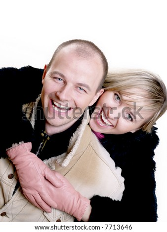 An attractive young woman embracing her handsome husband/winter - stock photo