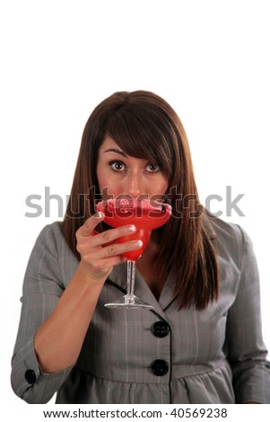 an attractive young woman enjoys her cocktail, isolated on white, with room for your text - stock photo