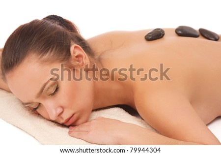 An attractive young woman getting a spa treatment, isolated on white