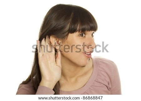 An attractive young woman hand attached to his ear, listening to gossip. Isolated on white background