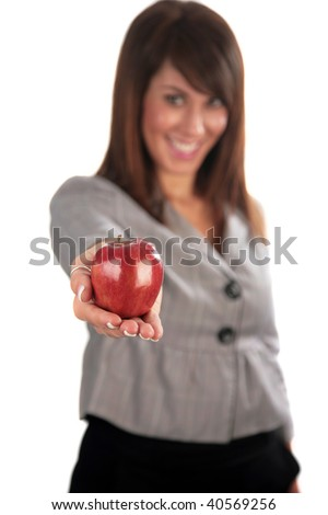 an attractive young woman hold a red apple, isolated on white, with room for your text. focus on her hand and apple for a forced perspective - stock photo