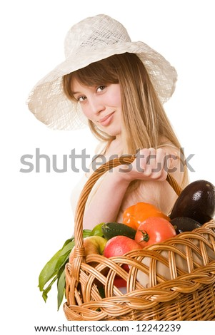 An attractive young woman holding a basket of delicious fresh vegetables. Isolated on white. - stock photo